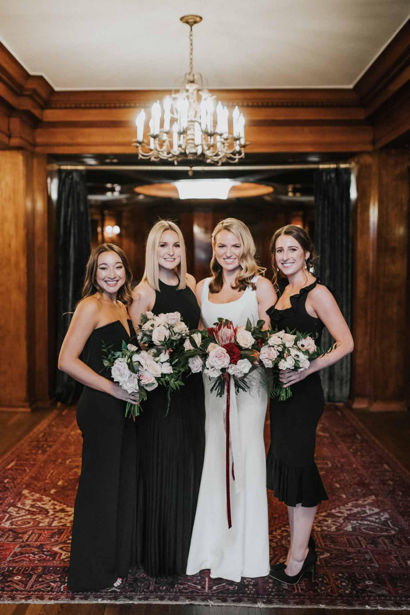 bride and bridesmaids pose with bouquets
