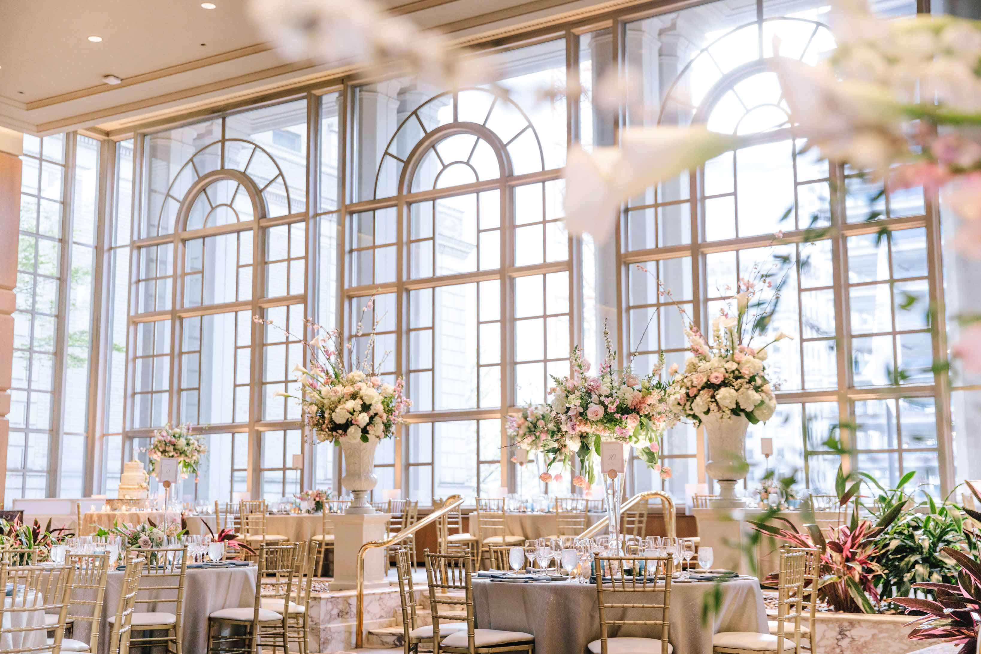 Garden Room of the Fairmont Olympic Hotel decorated with tall centerpieces for a spring garden wedding