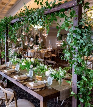 wedding reception with overhanging greenery and candles