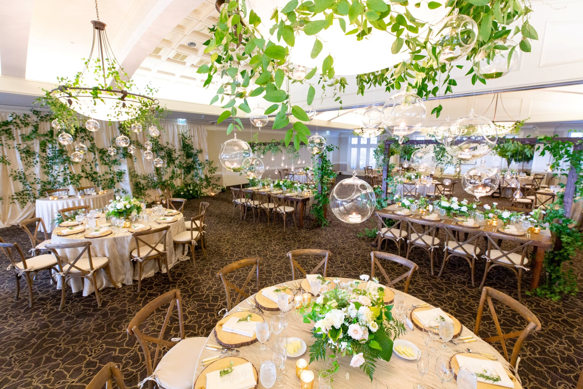 Midsommer night's dream wedding reception with hanging greenery and votives