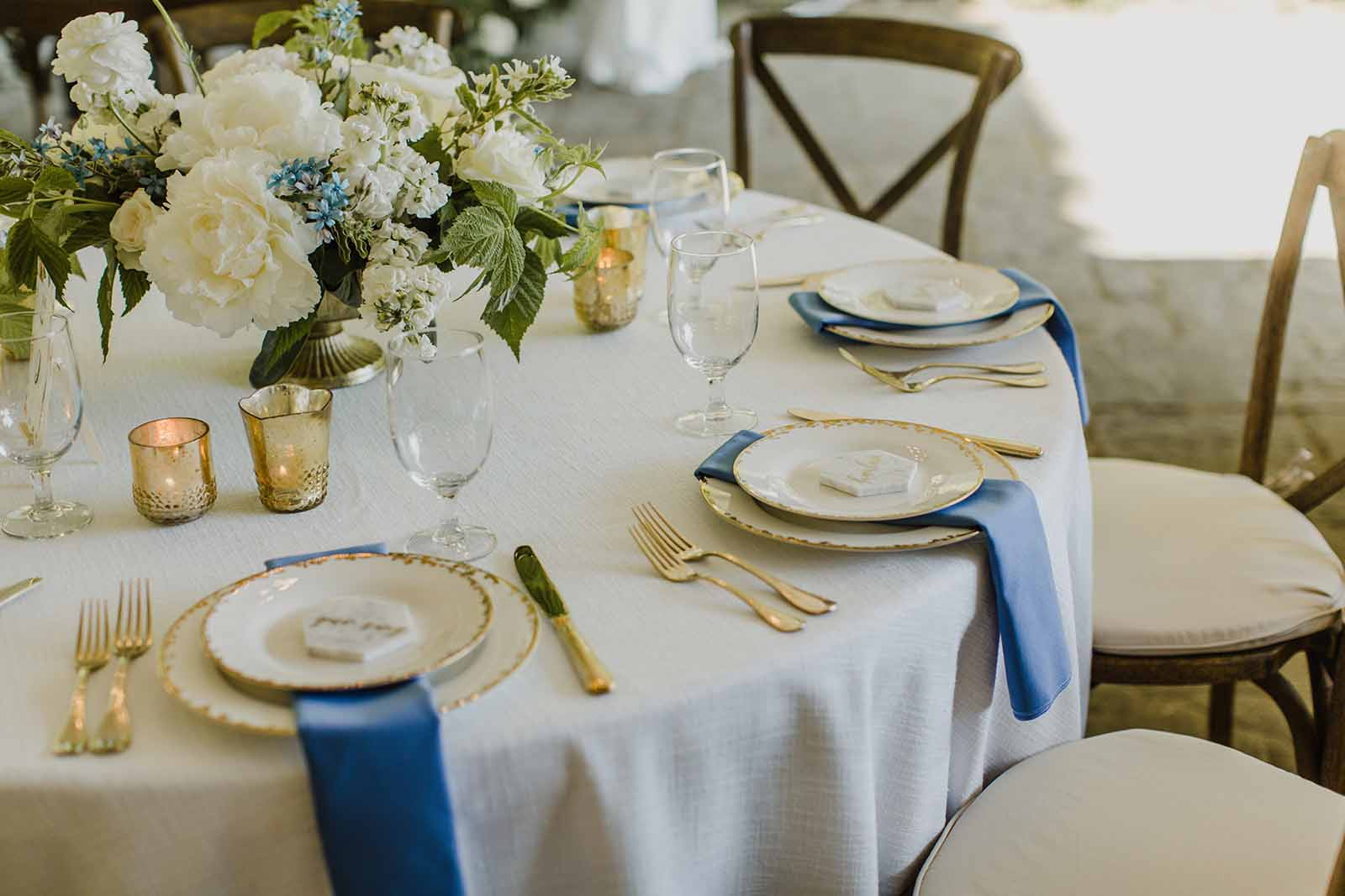 Cream and blue wedding reception with gold compote arrangements, designed by Flora Nova Design, Seattle.