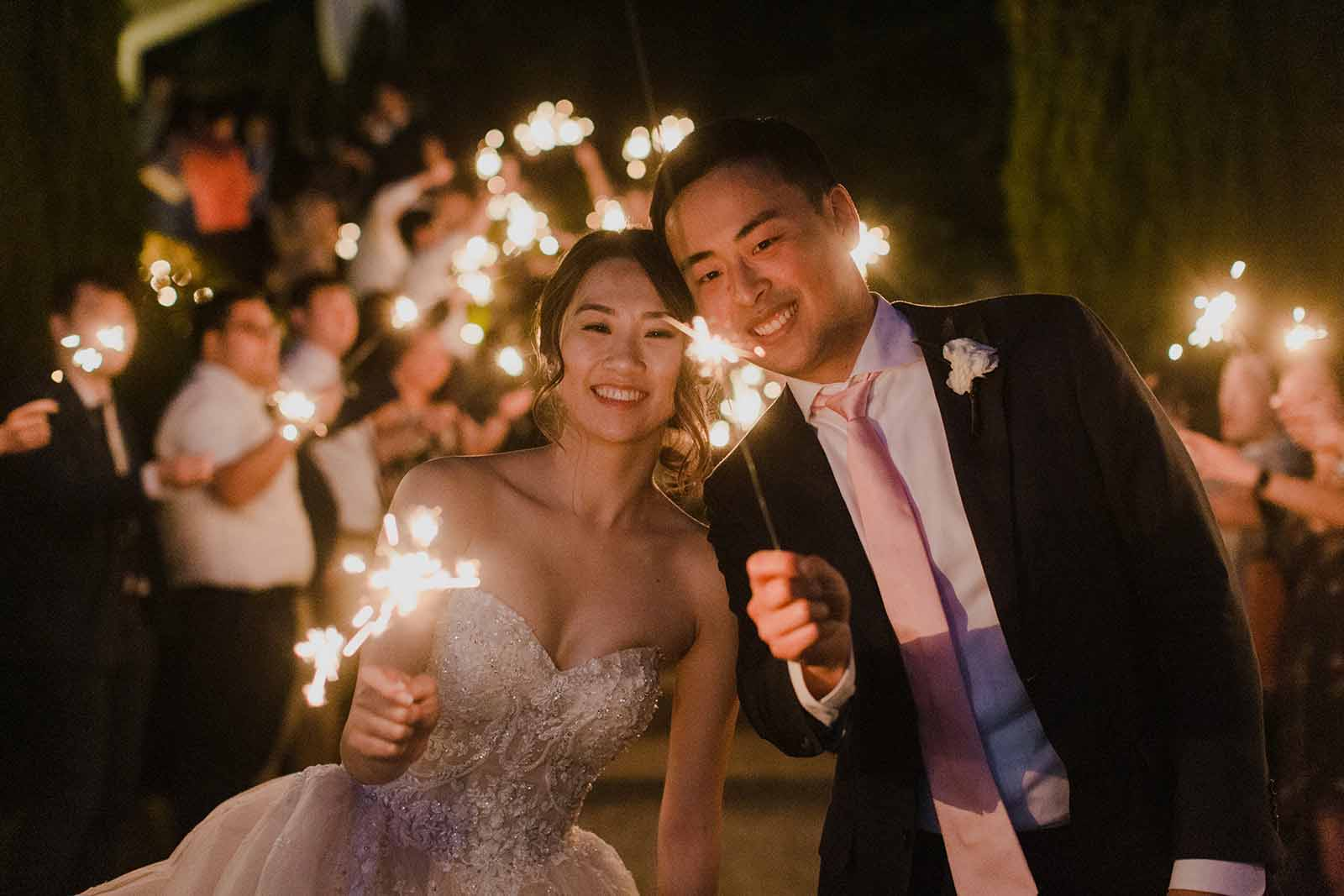 Sparklers at this June Chateau Lill wedding.