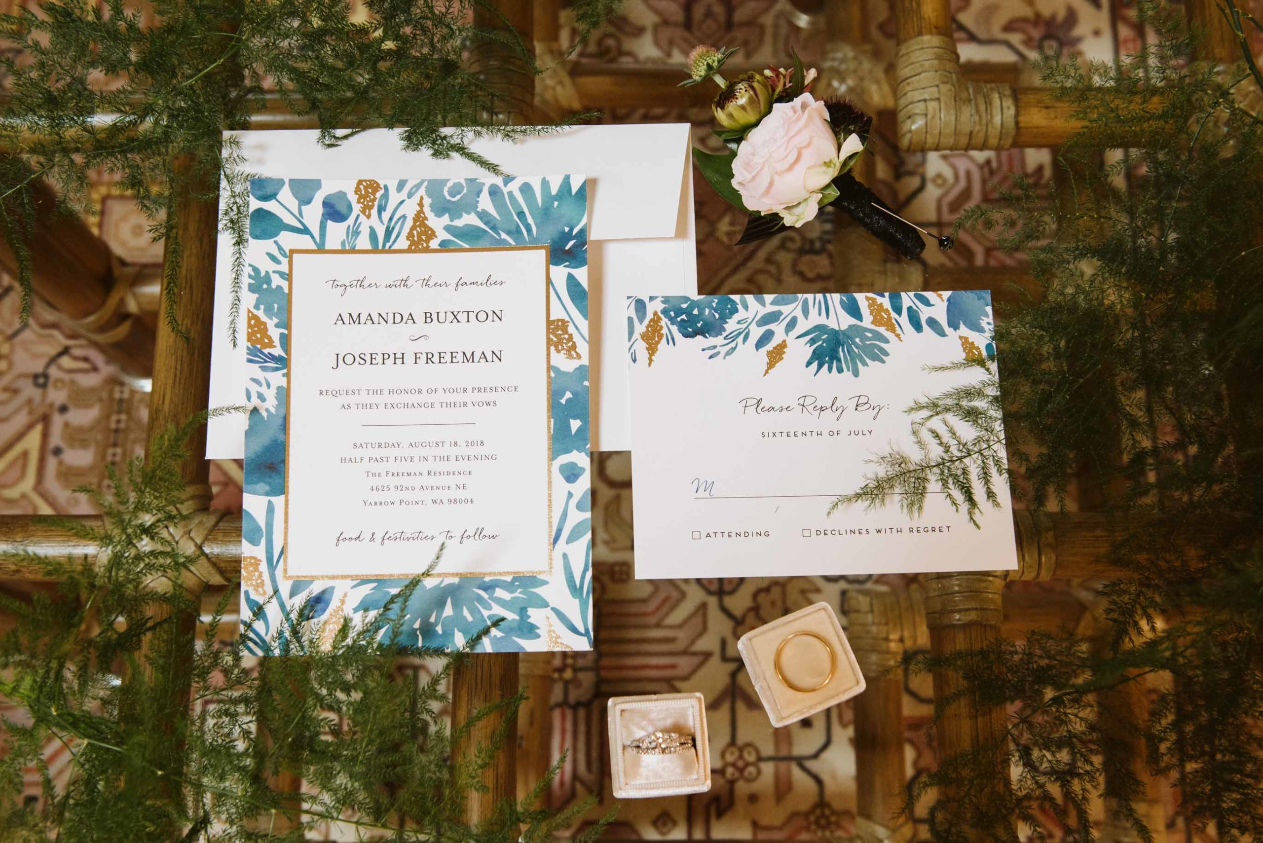 Invitation suite with botanical design in teal and mustard yellow for a backyard wedding.