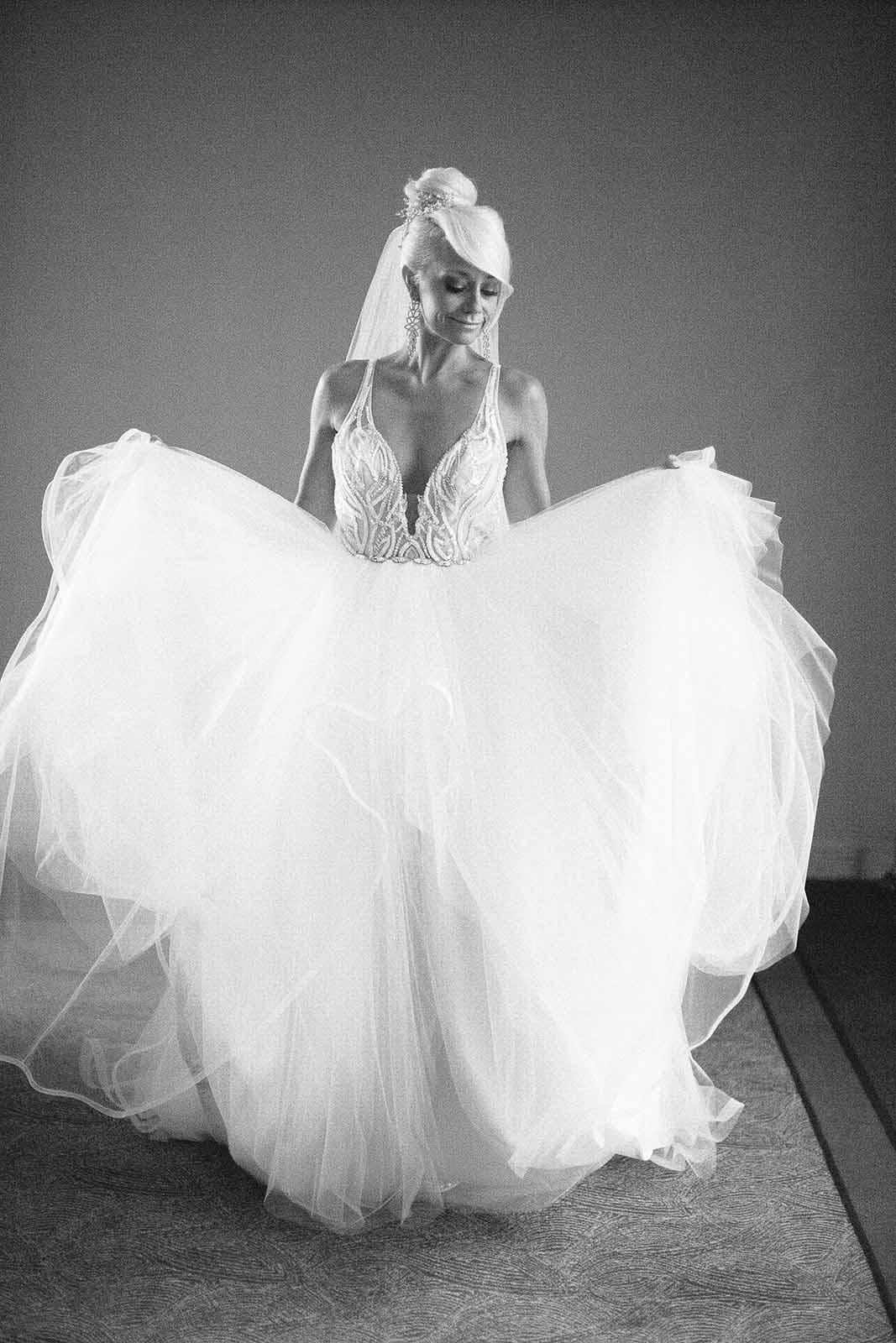 Formal black and white bridal photo in her full skirted fluffy ballgown dress