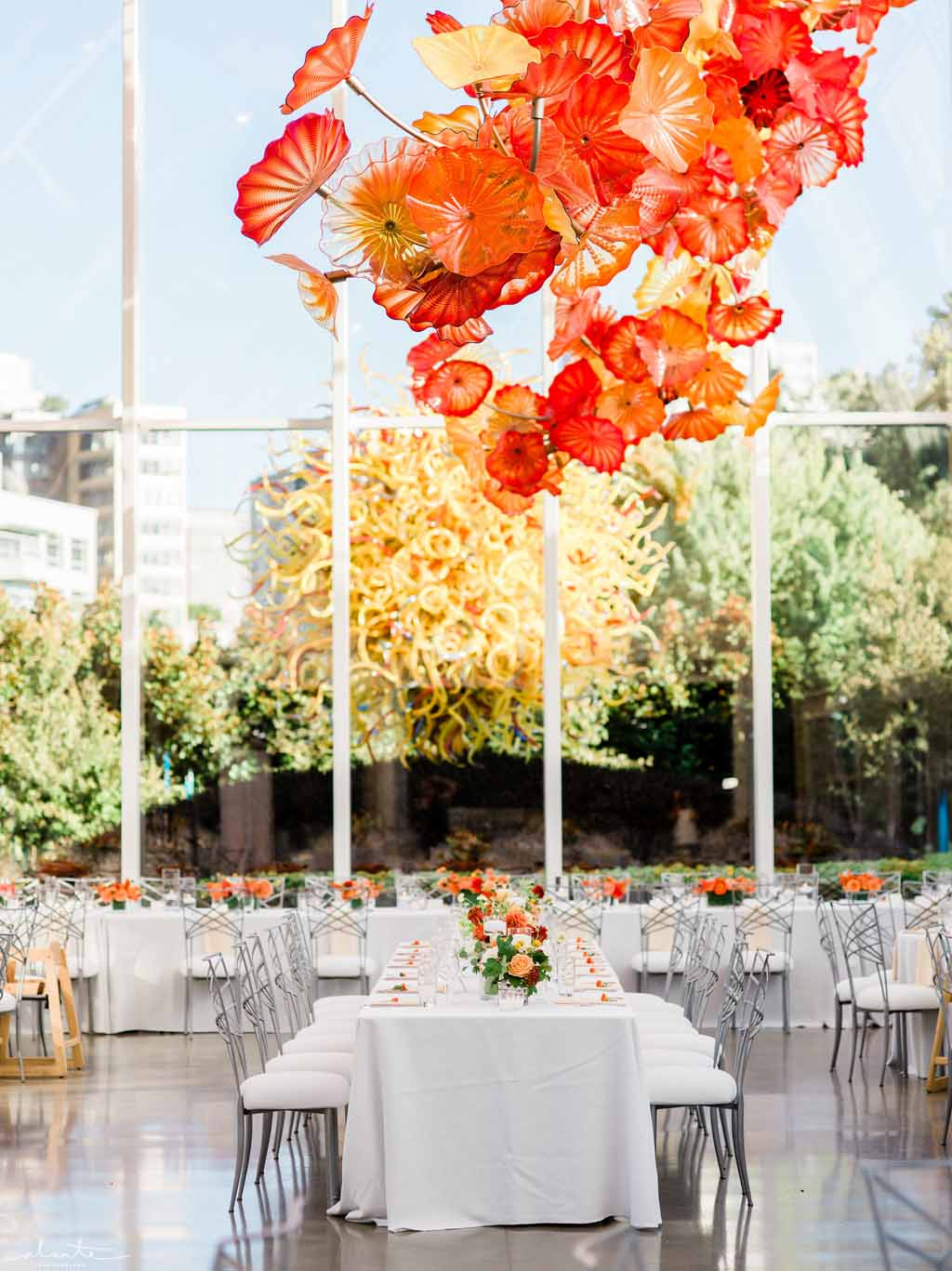 Orange wedding reception at Chihuly Seattle | Flora Nova Design