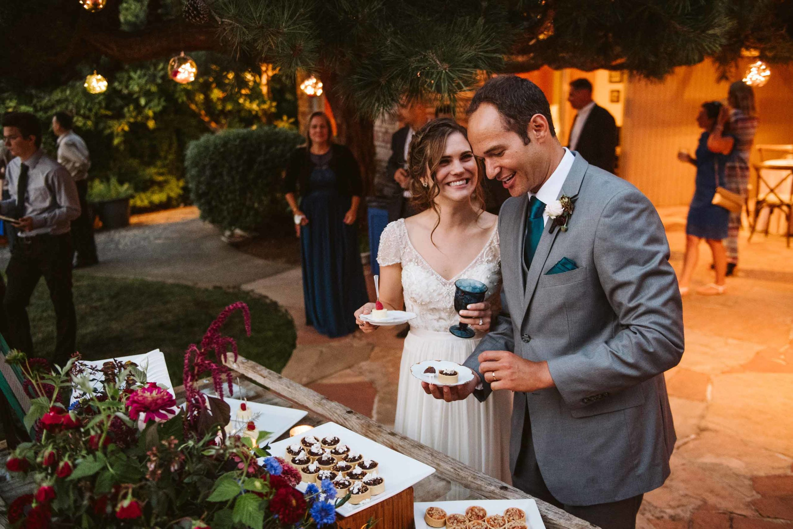 Bride and groom at the buffet of their backyard summer wedding