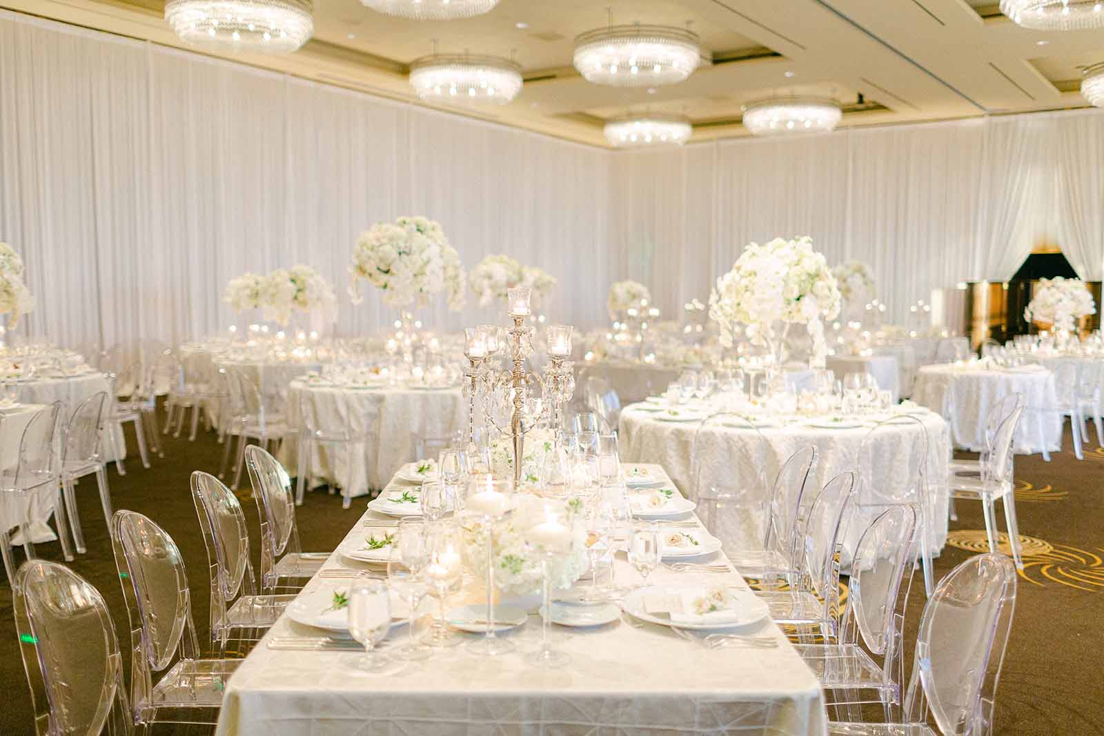 Formal Four Seasons Seattle ballroom white orchid wedding reception, mix of round and rectangle tables with lucite ghost chairs