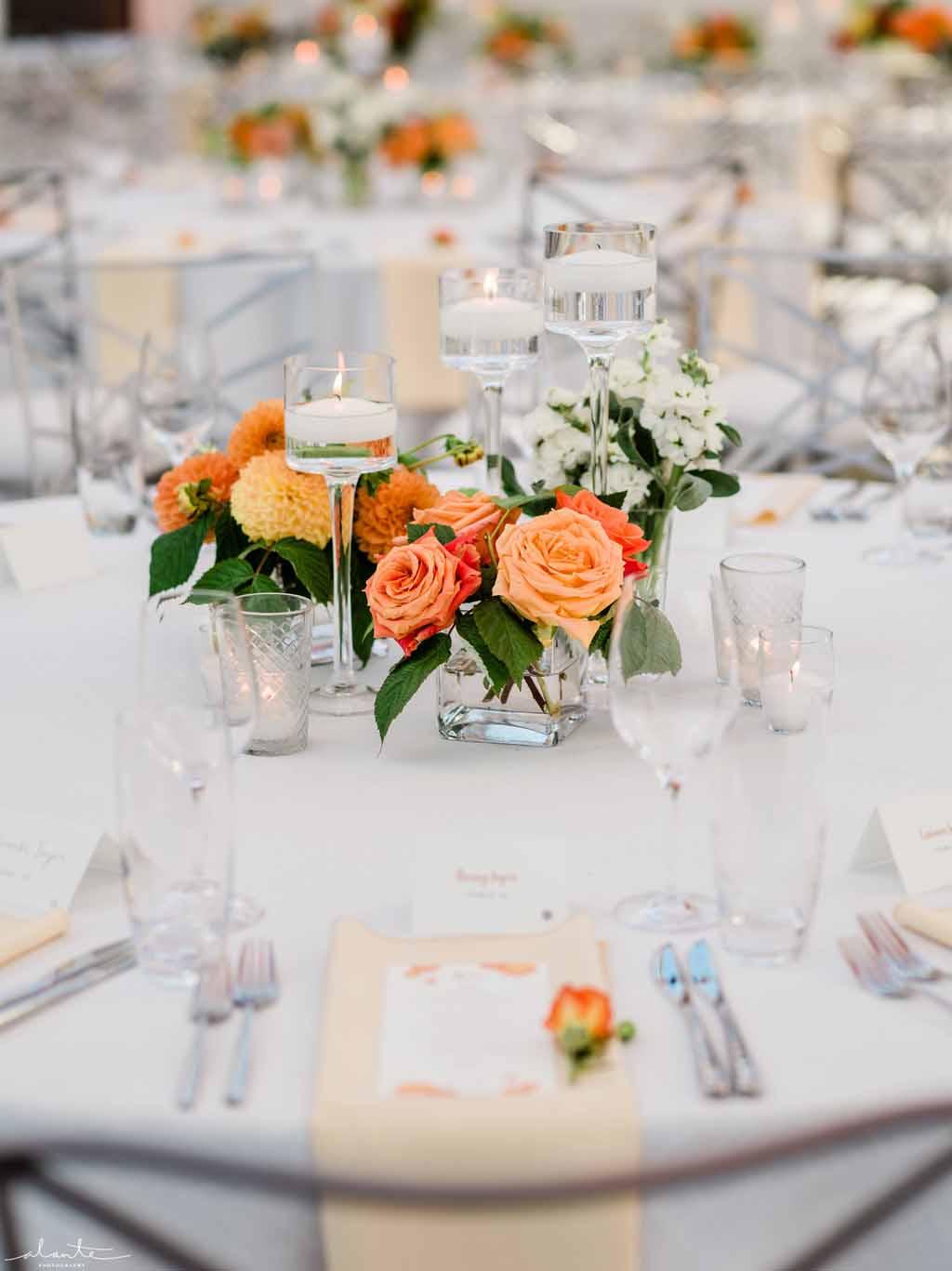 Low composite centerpiece with orange roses and dahlias summer wedding Designed by Flora Nova Design