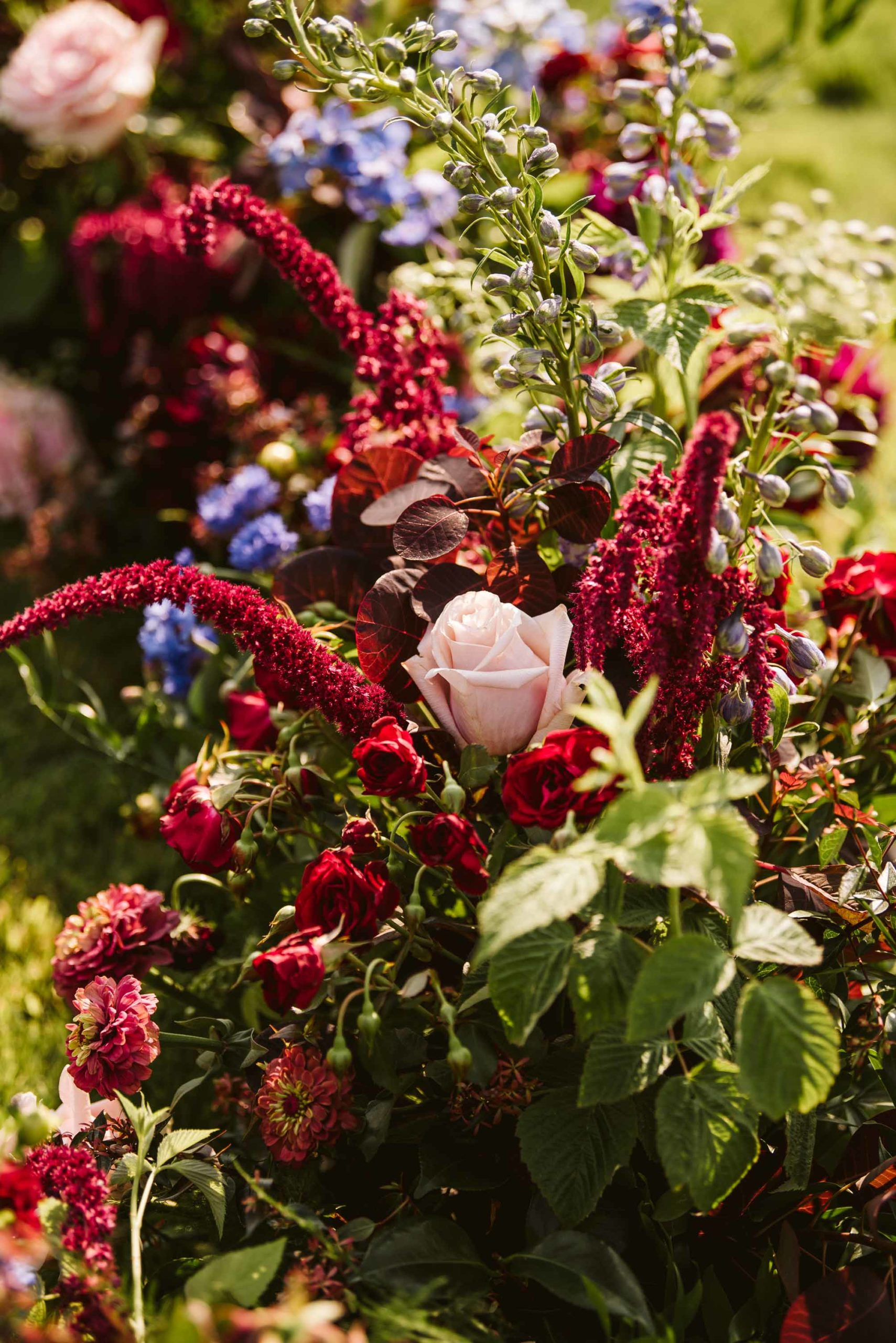 A close look at the burgundy and blush wedding flowers for a backyard ceremony on Lake Washington
