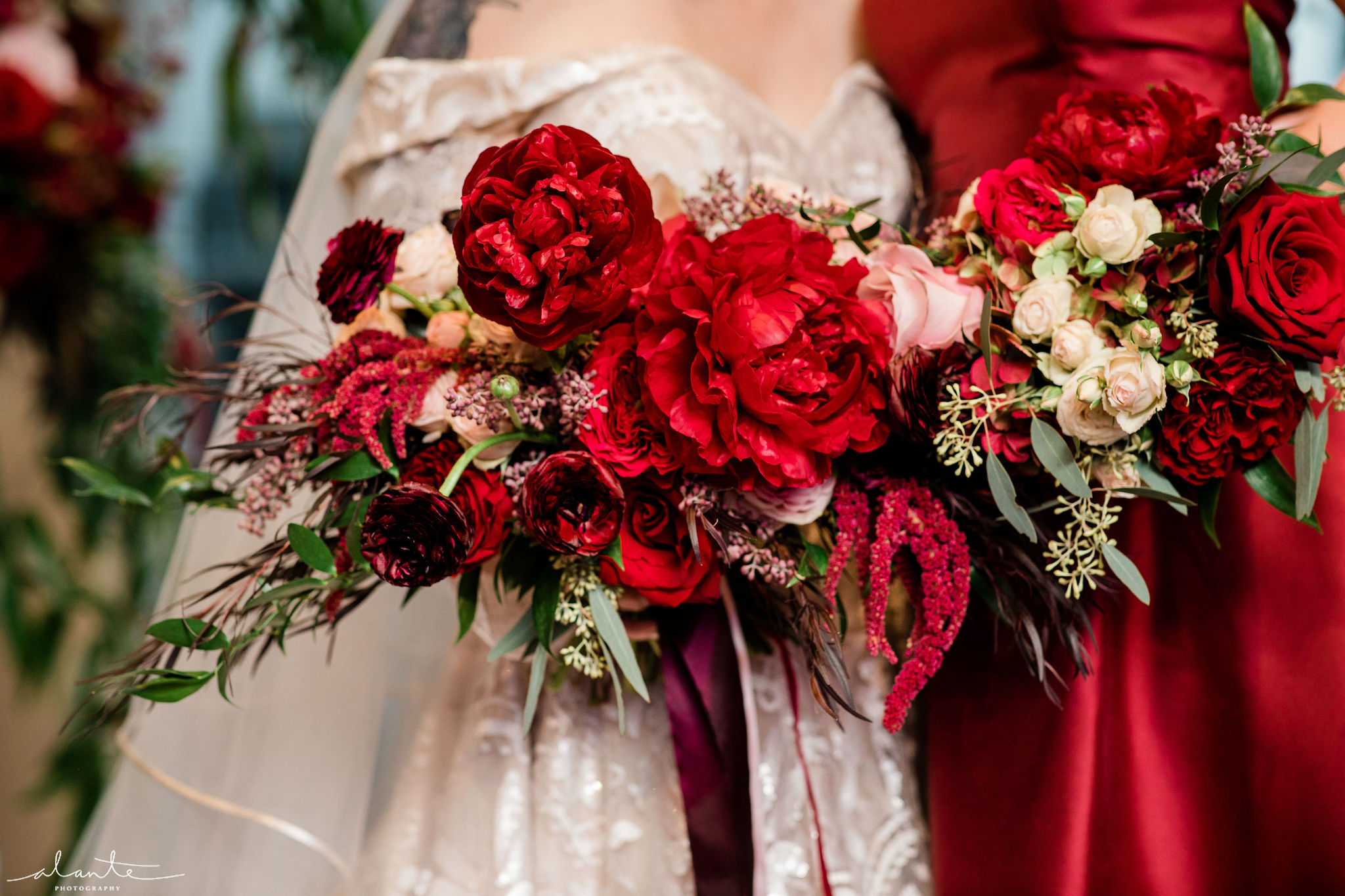 Red winter wedding bridal bouquet of peonies roses, and ranunculus | Flora Nova Design Seattle