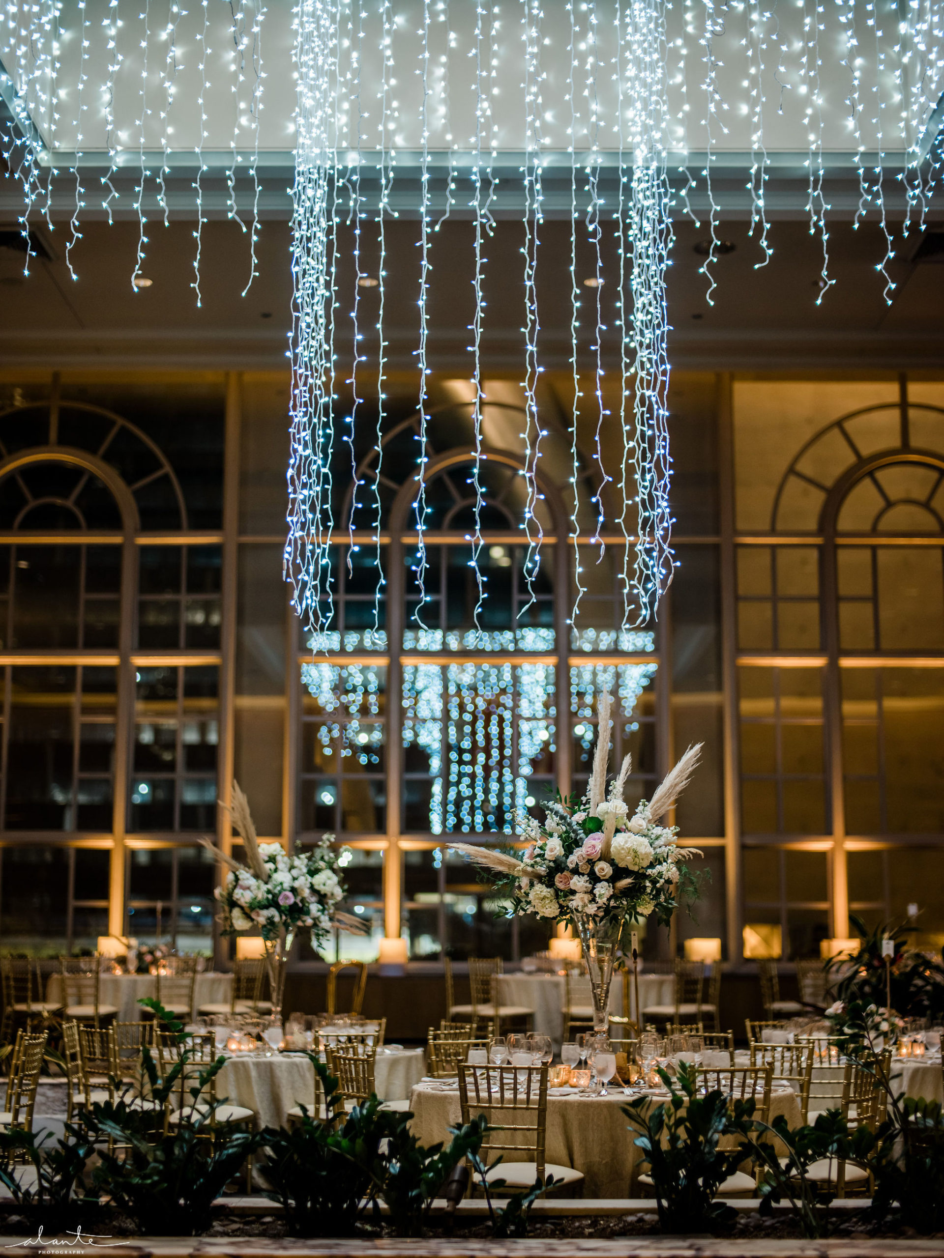 Holiday light chandelier hanging in the Garden Room at Fairmont Hotel in Seattle for a winter wedding reception with floral by Flora Nova Design