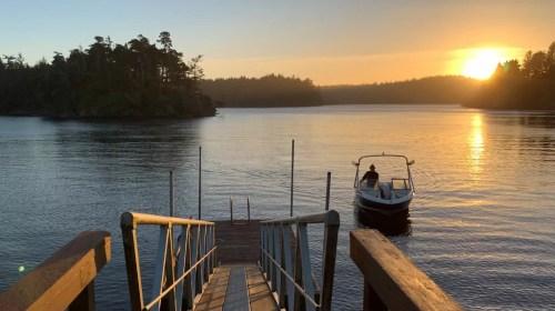 floras lake boat sunset