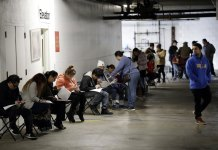 A Record 6.6 Million Seek US Jobless Aid as Layoffs Mount