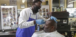 Barber shops, hair and nail salons reopen in Florida