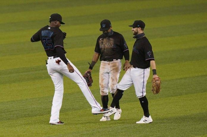 Marlins win virus-delayed home opener, beat Braves 8-2