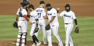 Marlins keep up playoff push, edge Nats to open twinbill