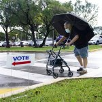 Early in-person voting begins in key swing state of Florida