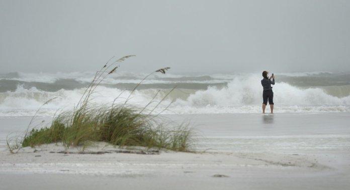 Tropical Storm Eta dumps blustery rain on Florida west coast people photos