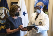Congress averts shutdown; fight continues over pandemic aid