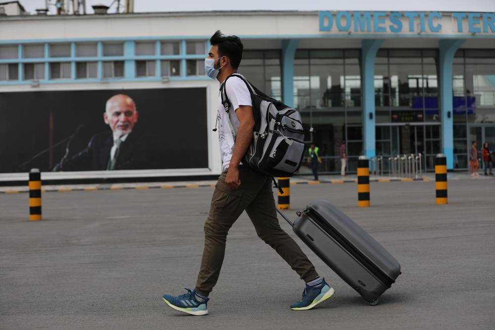 Afghan president flees country as Taliban move into Kabul