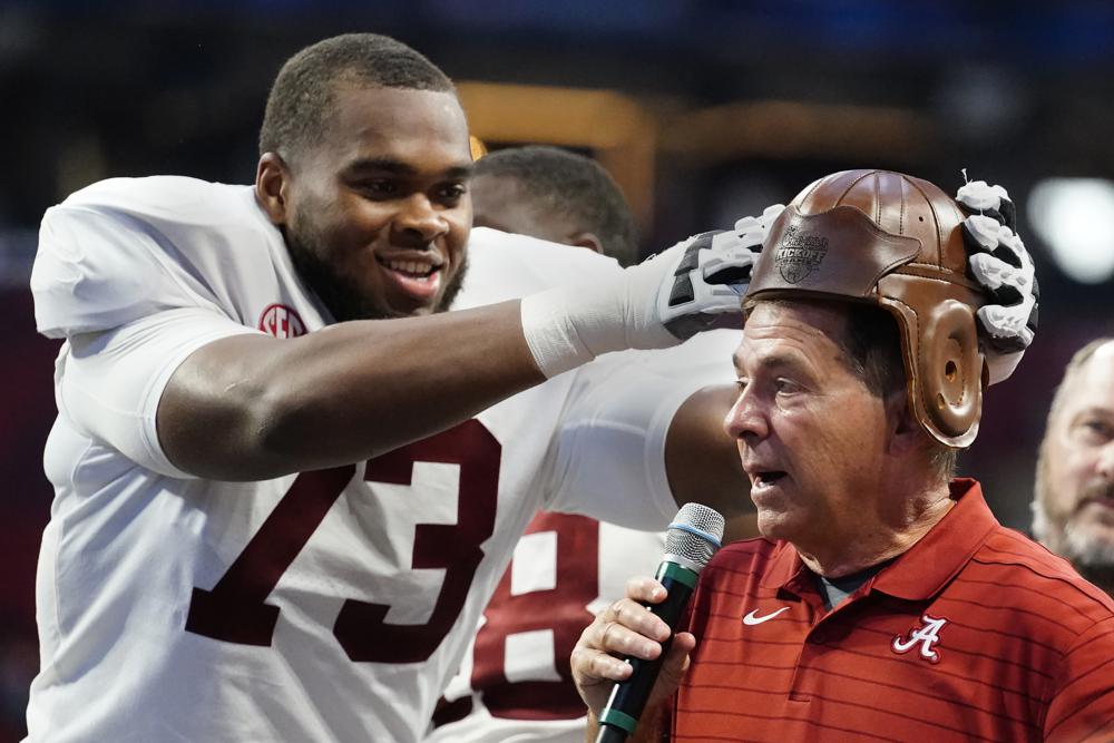 Column: College football survives 1st week of player pay
