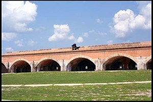 The ocean face of Fort Pickens had both barbette (the upper level), and casemate (the lower level, inside the arches) mounted guns. The cannon on the barbette level is an 8-inch Rodman, similar to the type of weapon mounted in the fort late in the Civil War, and a similar weapon was still emplaced there until 1901.