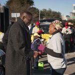 Ron Davis visiting crowd before the MLK Parade