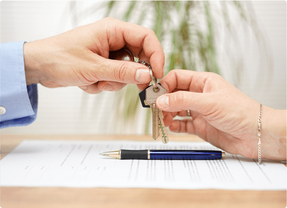 a lawyer handing the client keys to their property from a distribution