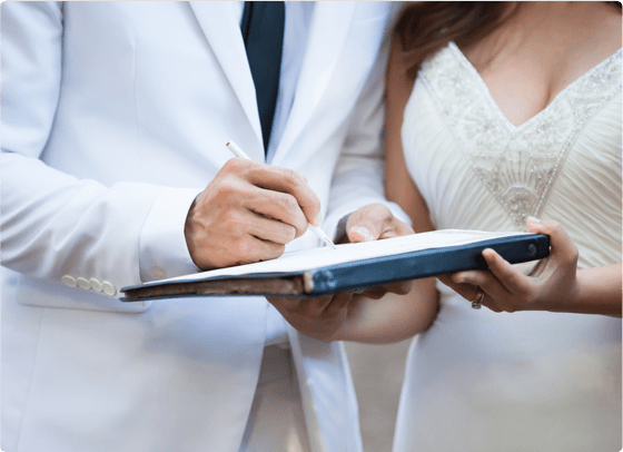 a couple signing a prenuptial agreement