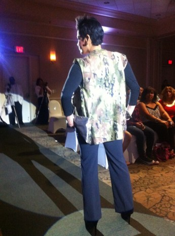 """Jarix Fashions' """"Battlefield"""" collection features this jacket with a camouflage back and back-flipped bottom panels for pockets. Source: Mellissa Thomas."""