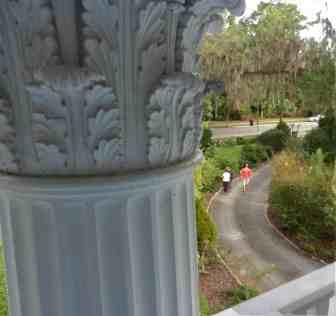Corinthian columns seen from second floor deck of Herlong Mansion are huge.
