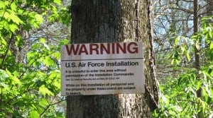 Warning signs for Avon Park bombing range lined one side of the Arbunkle Creek.