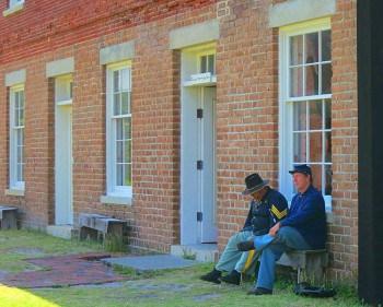 Two historical reenactors capture the Civil War period at Fort Clinch.