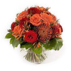 ramo-de-rosas-y-gerberas-en-tonalidades-naranjas.y.rojas