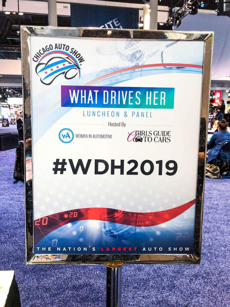 What Drives Her Luncheon and Panel Sign