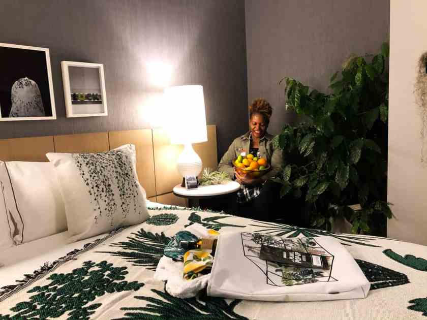 woman holding bowl of fruit in hotel room
