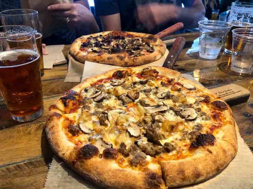 Pizza and beers on a table