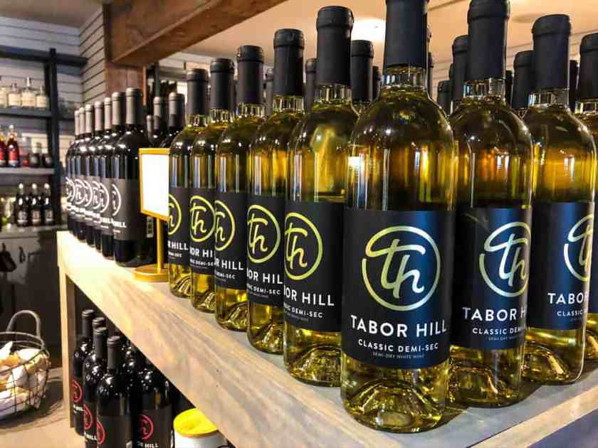 Tabor Hill Classic Demi-Sec wine bottles on stocked shelf in Southwest Michigan wine country