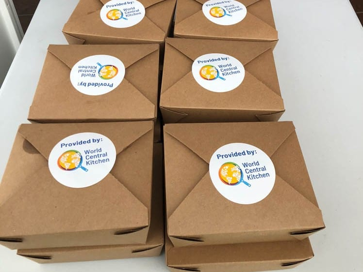 Boxes of meals from the Girl & the Goat restaurant at ESBN Washington Park Community Center