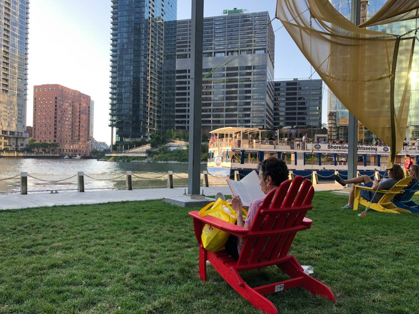 woman sitting outdoors at Chicago River Walk