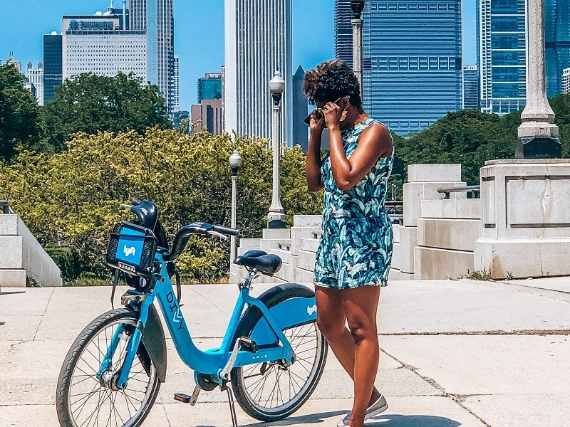 Woman standing next to bike in Grant Park Chicago