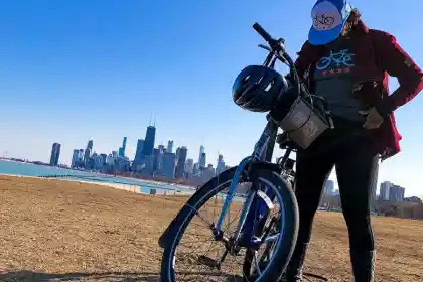 Woman standing next to a bike a the Chicago Lakefront on a break during a guided chicago bike tour