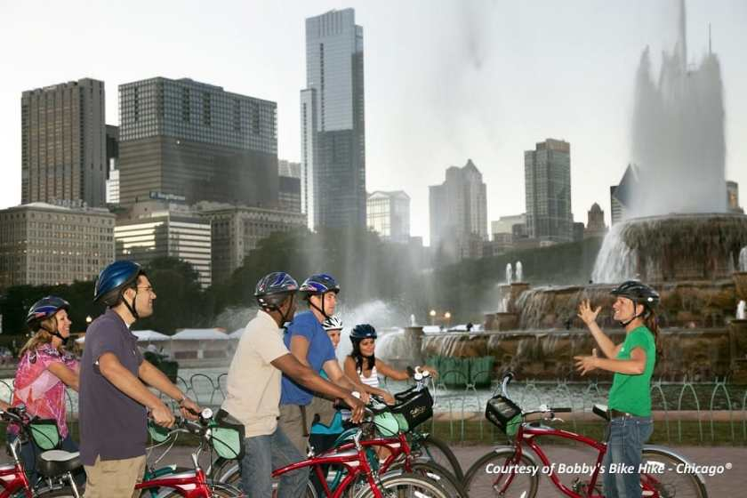 A group of people on a bike tour at Buckingham Fountain