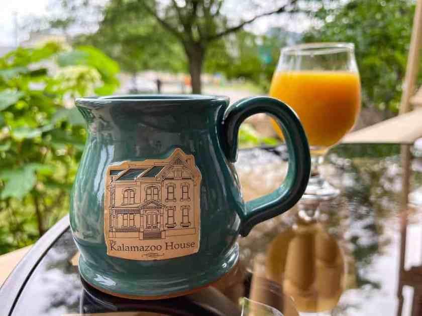 coffee mug with Kalamazoo House written on it