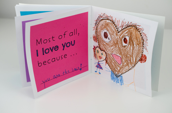 """Book fanned open to page that reads """"Most of all, I love you because..."""""""