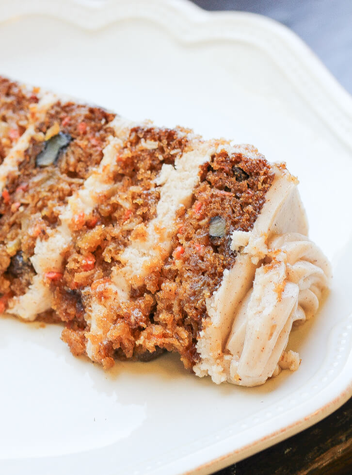 A slice of six layer pumpkin carrot cake
