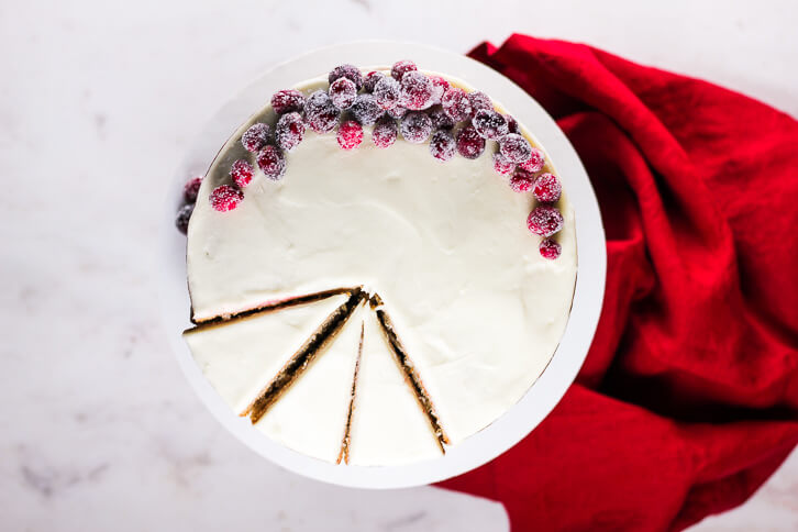 Slices of cranberry apple cake with cream cheese frosting