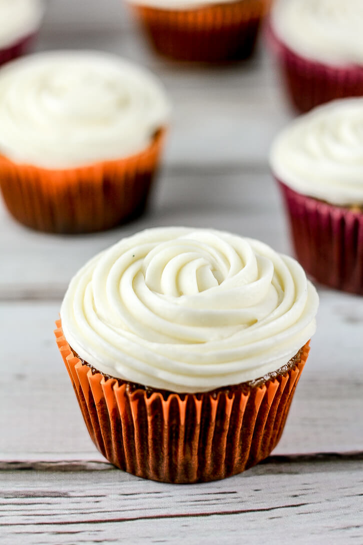 Swirls of cream cheese frosting are the perfect complement to these pumpkin carrot cupcakes