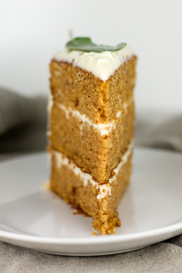 A slice of sweet potato cake with brown butter sage frosting