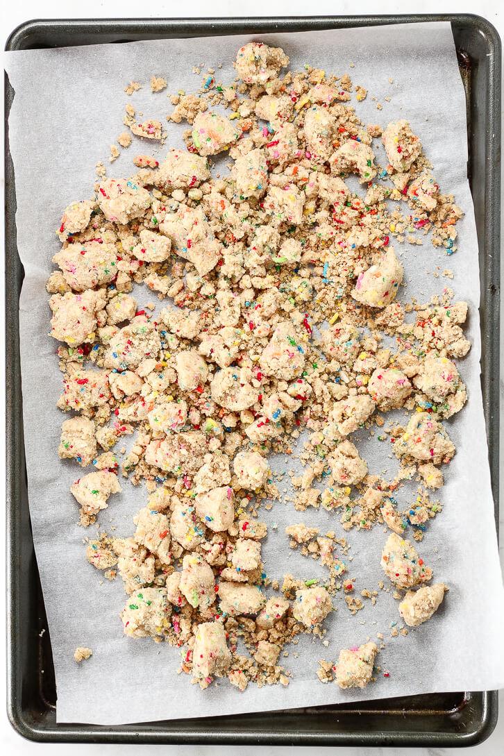 Birthday cake crumbs add the perfect crunch to this copycat milk bar birthday cake